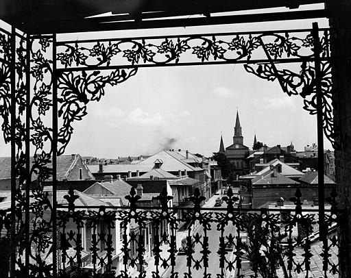 "This is a general view of a street in New Orleans, seen through the iron lace-works that is characteristic of the balconies in the Vieux Carre, the ""Paris of America"", Aug. 31, 1945. It portrays the beauty awaiting visitors who can"