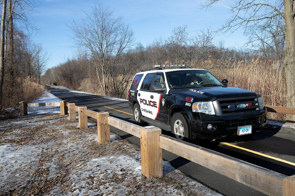 Police investigate an untimely death on the Farmington Canal Heritage Trail near Schoolhouse Road in Cheshire, Tues., Feb. 19, 2019. Dave Zajac, Record-Journal