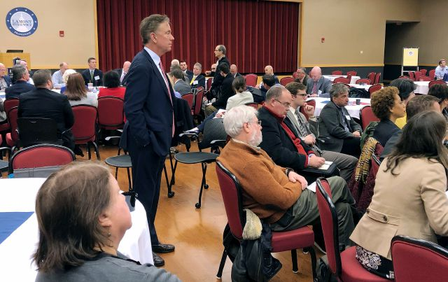 Incoming Connecticut Gov. Ned Lamont, standing at left, listens to members of one of the 15 transition public policy groups he formed to help provide recommendations for his new administration, Tuesday, Nov. 27, 2018, at Eastern Connecticut State University in Willimantic, Conn. This group of more than 450 people gathered to offer education-related proposals. (AP Photo/Susan Haigh)