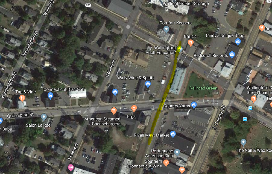 A car temporarily put a stop to trains moving through Wallingford Thursday night when it got stuck on tracks off Quinnipiac Street. | Google Maps