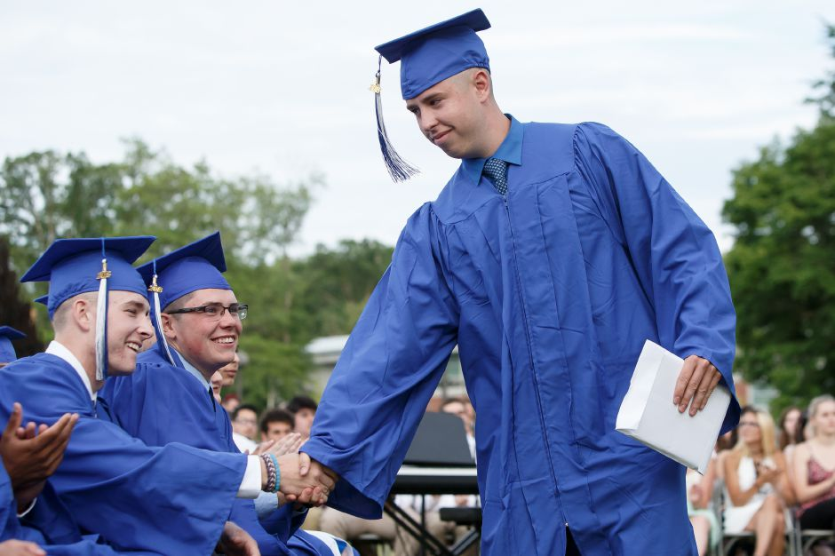 Aeron Heidgerd is congratulated after receiving his diploma Friday during Lyman Hall High School