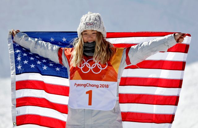 Chloe Kim, of the United States, celebrates winning gold in the women
