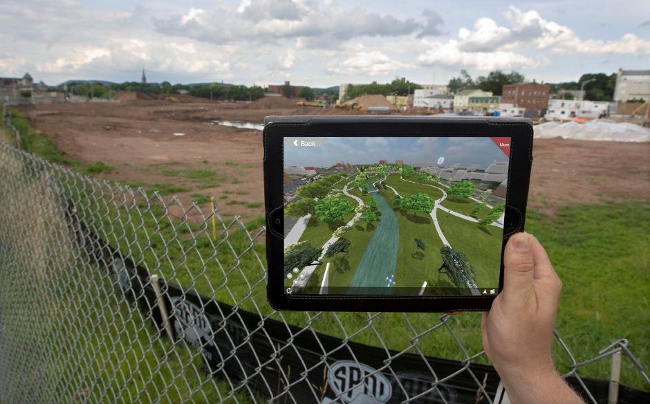 A photo illustration showing a virtual tour of the Meriden Hub project using an application on a tablet computer, Thursday, July 17, 2014. The app, 123 View, shows a 3-D rendering of what the finished project will look like from your location. This particular view is from the southwest corner of the Hub near the intersection of E. Main St. and State St. | Dave Zajac / Record-Journal
