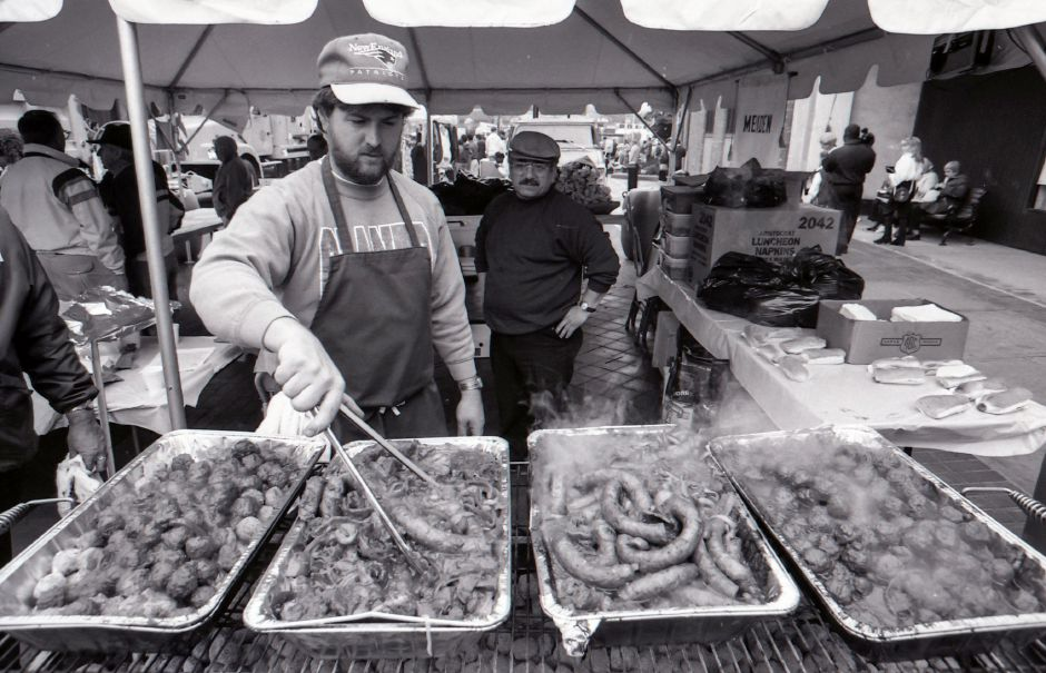 RJ file photo - Meriden Unison Club member Jeff Cerasale stirs sausages at the club