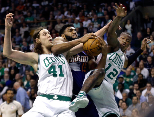 Phoenix Suns forward Alan Williams (15) controls a rebound against Boston Celtics center Kelly Olynyk (41) and guard Terry Rozier (12) during the first quarter of an NBA basketball game, Friday, March 24, 2017, in Boston. (AP Photo/Elise Amendola)