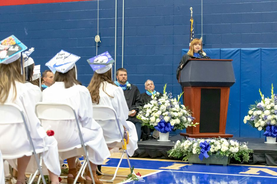 Plainville Superintendent of Schools Maureen Brummett addresses the graduating Plainville High School class of 2019, in a ceremony in the school