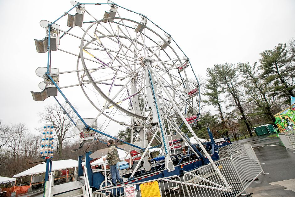 Sean Ermark, manager of Rainbow Amusement Co. of Sandy Hook, tests the Ferris wheel in preparation for Church of the Resurrection