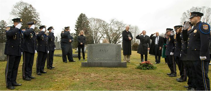 "Meriden police salute during an annual memorial service for infant David Paul at Walnut Grove Cemetery in Meriden Wednesday. The one-day-old boy was found frozen to death at the base of a tree in a South Meriden parking lot on Jan. 2, 1988. The police department adopted the child and gave him the name David Paul, which means ""God's beloved little man"" in Scripture."