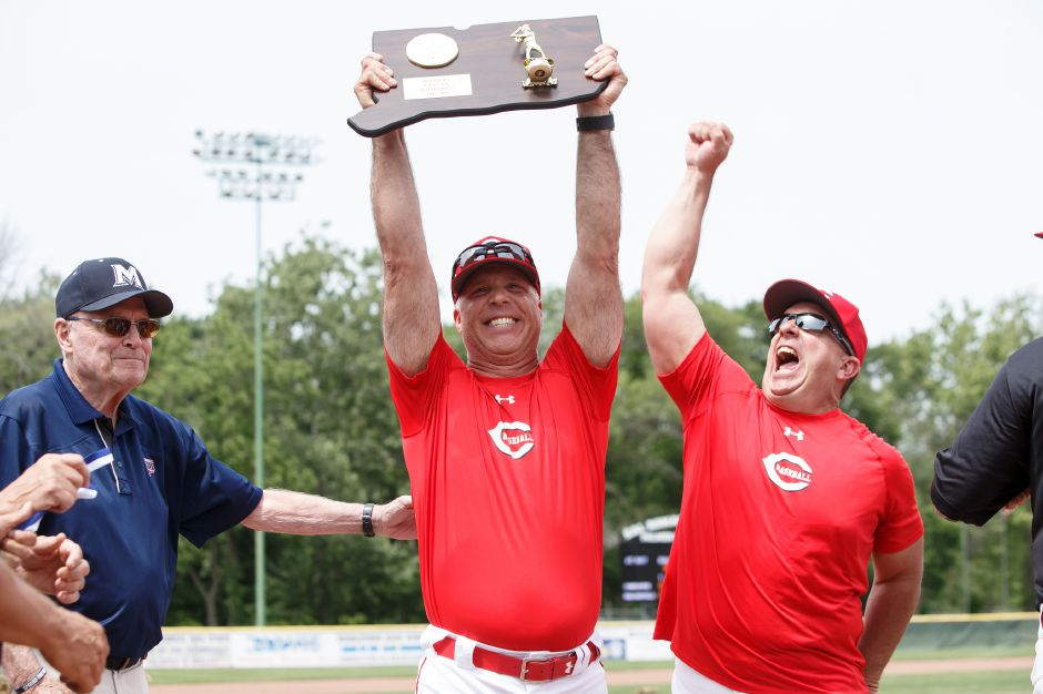 Cheshire baseball coach Bill Mrowka raises the CIAC Class LL championship plaque with assistant coach Mike Lussier after winning the title at Palmer Field this June. That 1-0 championship victory over Ridgefield proved to be the 250th and last of Mrowka's tenure with the Rams. On Thursday, he stepped down after 31 years in the program, including the last 21 as head coach. | Justin Weekes / Special to the Record-Journal