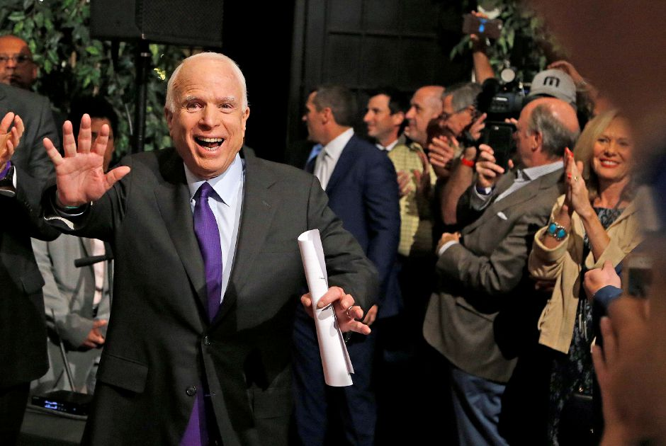 Sen. John McCain, R-Ariz. waves to supporters as he arrives for his victory party prior to officially announcing his victory over Democratic, Rep. Ann Kirkpatrick, D-Ariz., Tuesday, Nov. 8, 2016, in Phoenix. (AP Photo/Ross D. Franklin)