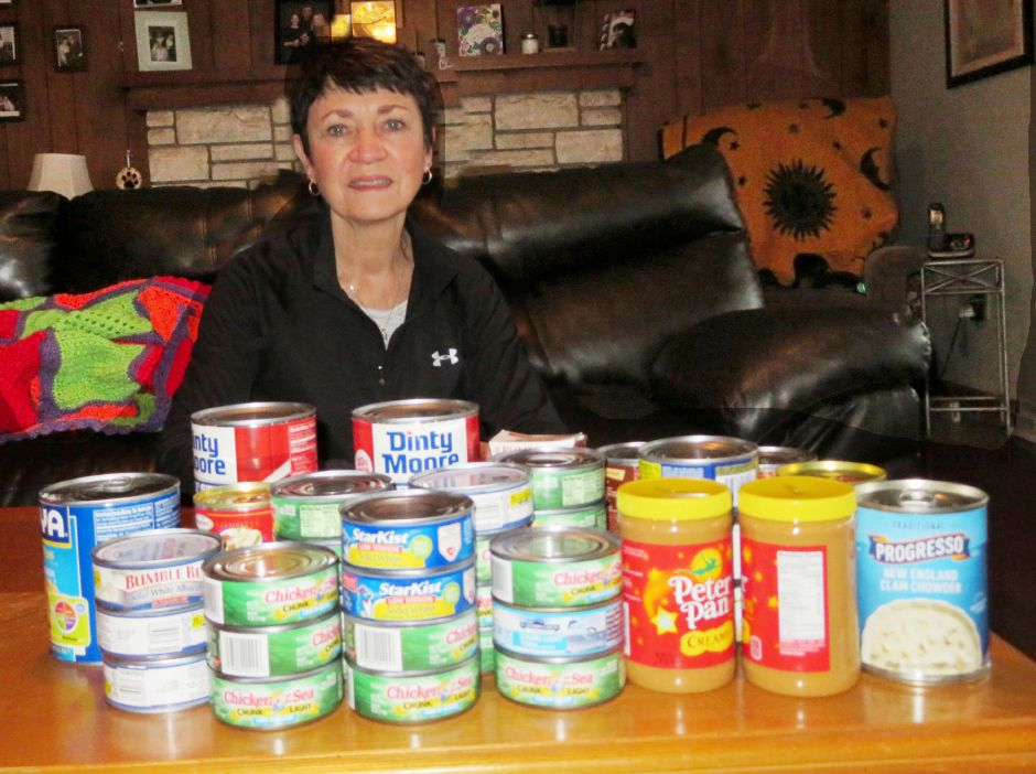 Lynn Montemurro, a retired Meriden teacher, is shown with the non-perishable food items collected for Master