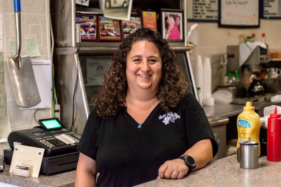 April Ouellette, daughter of original owner, Tom Caliendo, has worked at the family-run diner since she was 13 - Tom