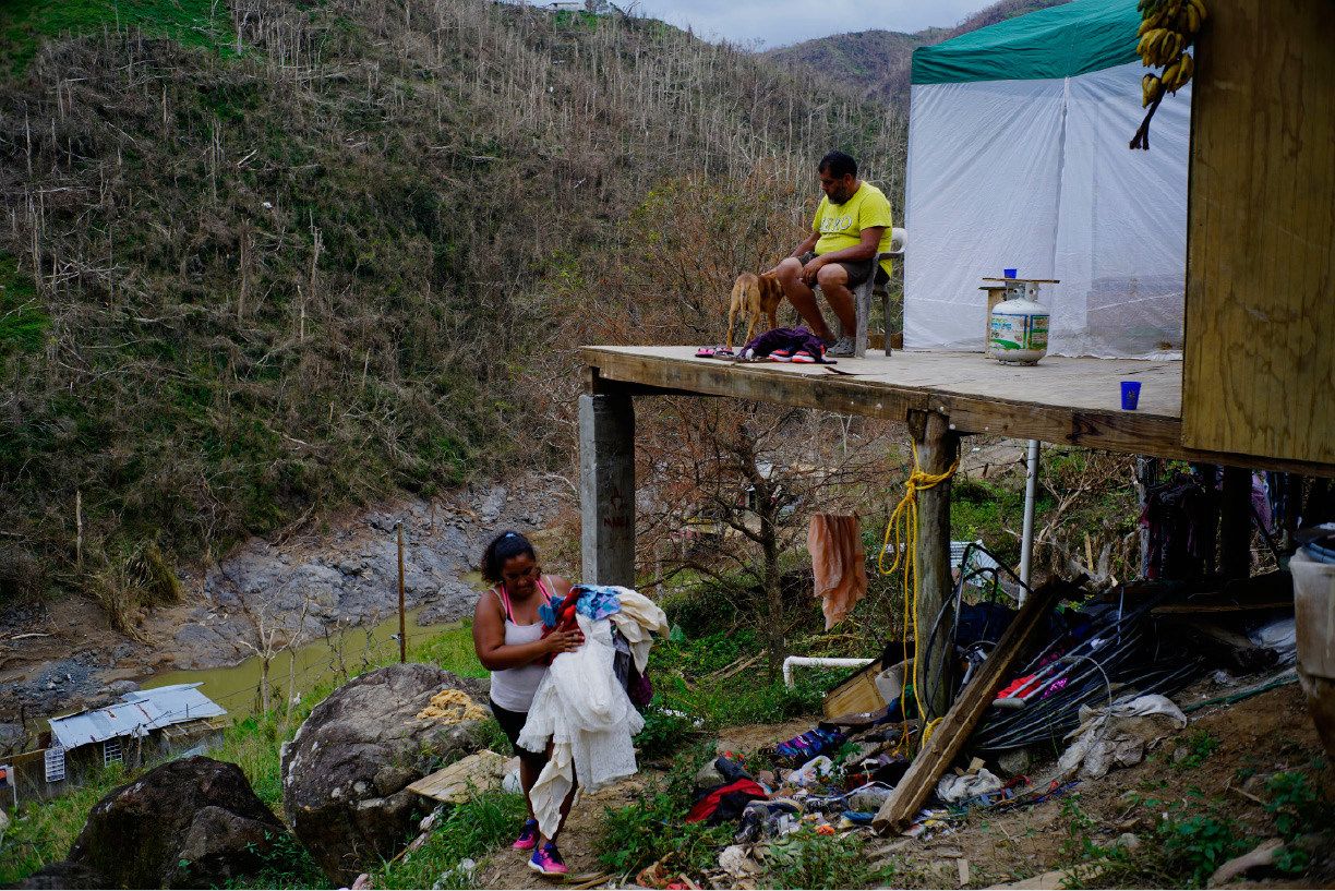 "CORRECTS FROM MORAVIS TO MOROVIS- Yadira Sortre and William Fontan Quintero clean their house, destroyed by Hurricane Maria in in Morovis, Puerto Rico, Sunday, Oct. 1, 2017. ""We lost everything."" Fontan said. They have three children, one lives in Chicago and two live with them in Puerto Rico. (AP Photo/Ramon Espinosa)"