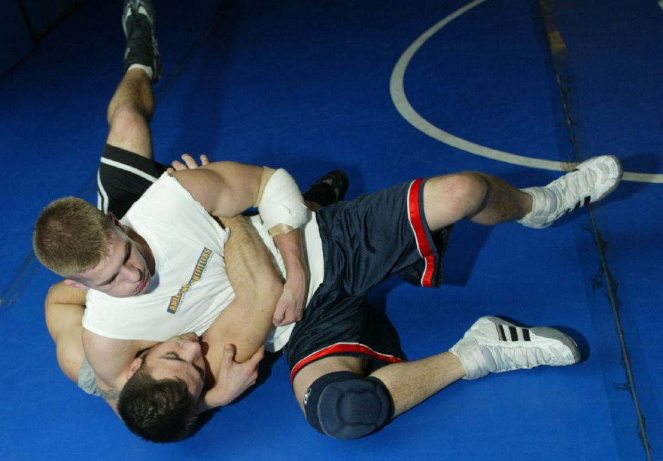 Southington High School top wrestlers Andy Liseo, bottom and Chris Lee, top practice Wednesday afternoon February 25, 2004.