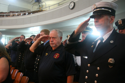 Members of the Wallingford Fire Department stand at attention at the 9/11 remembrance ceremony Sunday at the Wallingford Town Hall. | Lauren Takores, Record-Journal