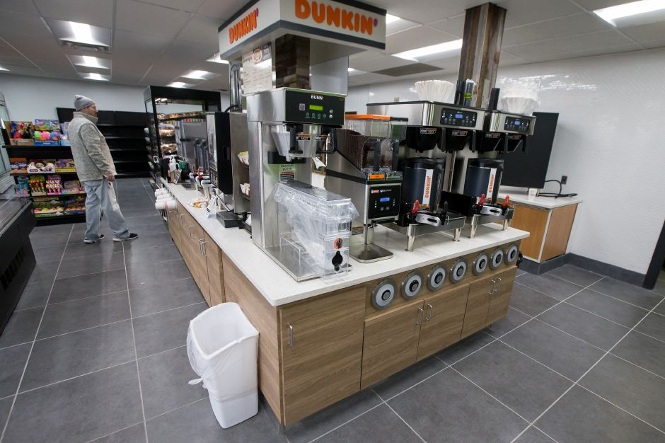 A customer shops the new island with donuts and coffee from Dunkin Donuts. The Citgo gas station on RT 5 in Wallingford Monday nears completion for it