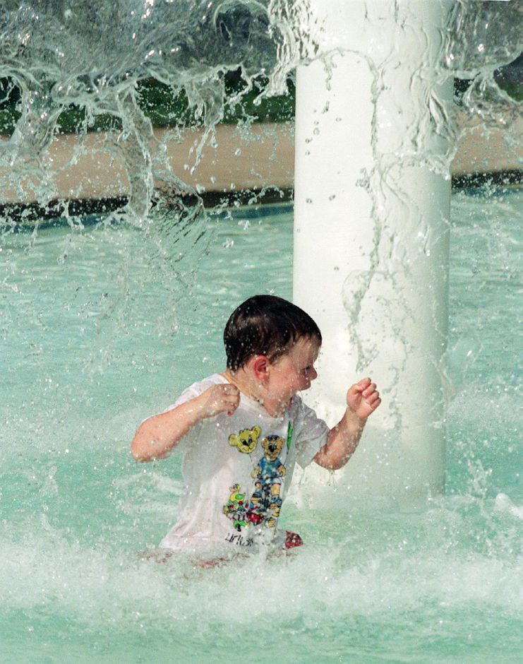 Stephen Peccerillo, 3, plays in the wadding pool at Southington