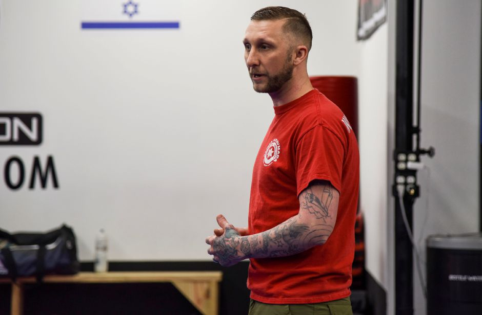 Robert Rand, owner of Krav Maga Southington, teaches participants how to stay safe in an active shooter senario, at the studio in Plantsville Friday, Feb. 23. | Bailey Wright, Record-Journal