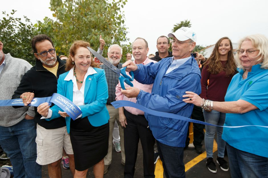 James Redeker CT DOT Commissioner cuts the ribbon Sunday during a Ribbon Cutting Ceremony for the Farmington Canal Heritage Trail on West Main in Cheshire September 9, 2018 | Justin Weekes / Special to the Record-Journal