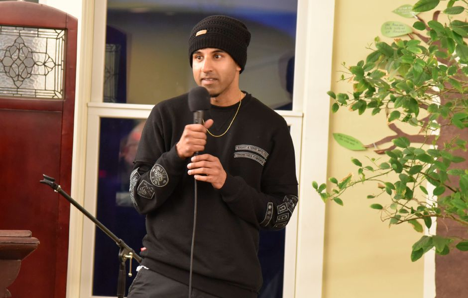 Alok Bhatt, community defense corrdinator for the Rights Alliance, addresses those gathered at the church to support Indonesian immigrant Sujitno Sajuti, who is facing deportation, on Friday, Feb. 2, 2018. | Bailey Wright, Record-Journal