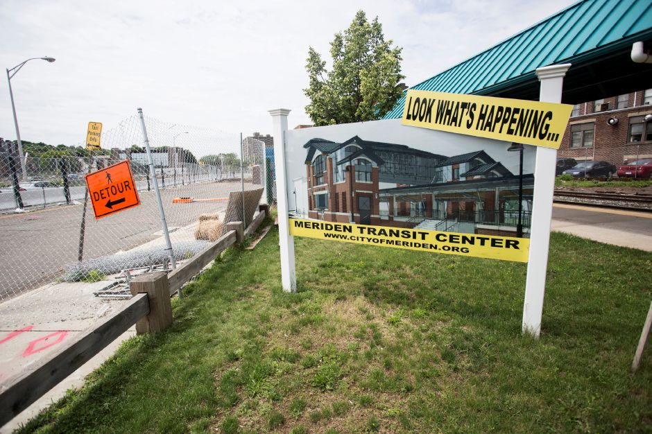 A sign next to the construction site shows a rendering of the new train station slated for downtown Meriden Thursday June 18, 2015. | Richie Rathsack/Record-Journal