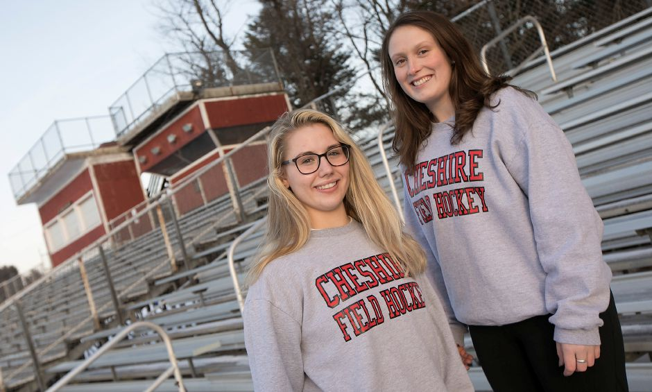 Seniors Mia Pulisciano, left, and Julia Schaff, both 17, pose in the stands at Cheshire High School, Friday, Jan. 19, 2018. The two field hockey teammates encourage sportsmanship in the student seating section during athletic events. Dave Zajac, Record-Journal