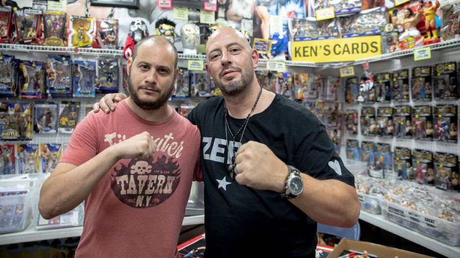 Peter Polaco, better known by his wrestling stage name Justin Credible, poses with a fan at Ken