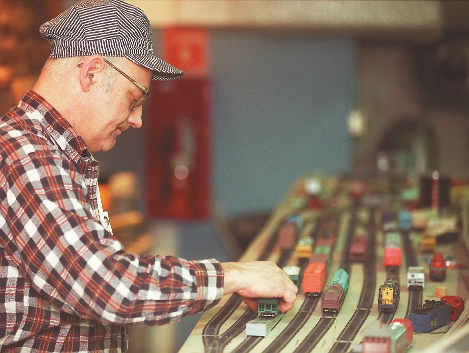 RJ file photo - Howard Crampton, treasurer of the New Haven Society of Model Engineers Inc., sets up a model train at the Wallingford Train Station, Aug. 1998.