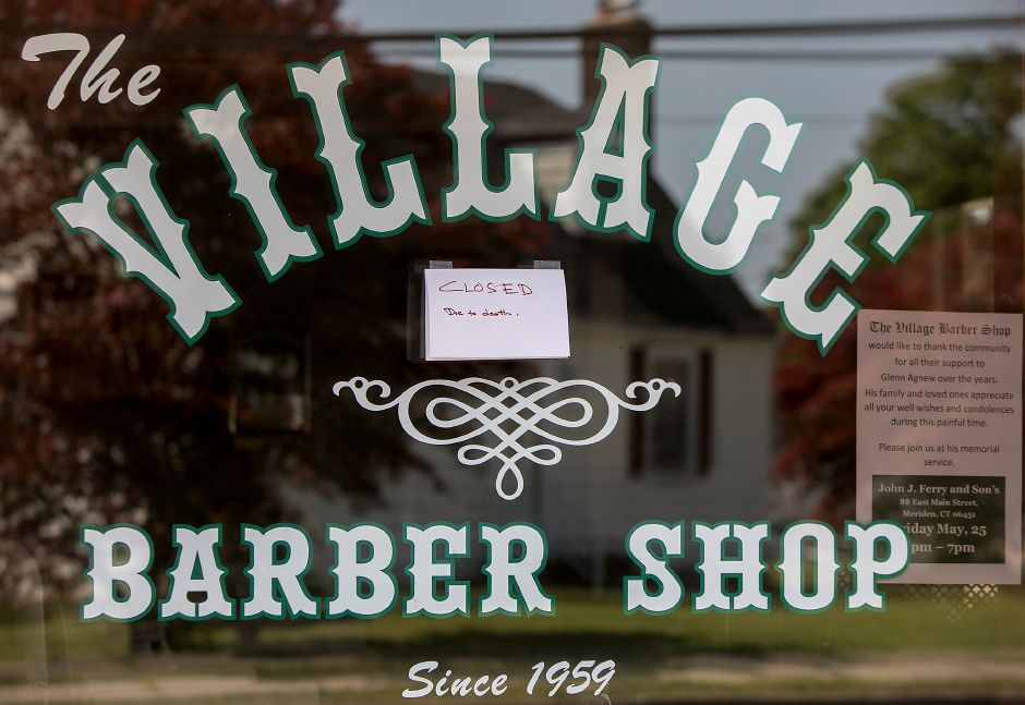 The Village Barber Shop on Main Street in South Meriden, Thursday, May 24, 2018. Owner Glenn Agnew died Monday as a result of a coronary. He was 48. Dave Zajac, Record-Journal
