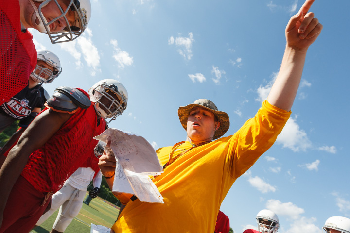 Sheehan's Pat Miller gives direction in a huddle Thursday in Wallingford June,19 2014 | Justin Weekes / For the Record-Journal