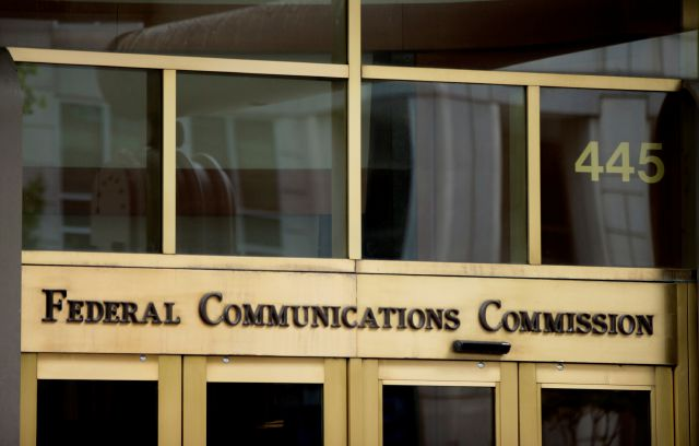 "FILE - This June 19, 2015, file photo, shows the entrance to the Federal Communications Commission (FCC) building in Washington. ""Net neutrality"" regulations, designed to prevent internet service providers like Verizon, AT&T, Comcast and Charter from favoring some sites and apps over others, are on the chopping block. Federal Communications Commission Chairman Ajit Pai, a Republican, on Tuesday, Dec. 12, 2017, unveiled a plan to undo the Obama-era rules that have been in place since 2015. (AP Photo/Andrew Harnik, File)"
