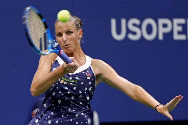 Karolina Pliskova, of the Czech Republic, returns a shot to Serena Williams, of the United States, during the quarterfinals of the U.S. Open tennis tournament Tuesday, Sept. 4, 2018, in New York. (AP Photo/Adam Hunger)