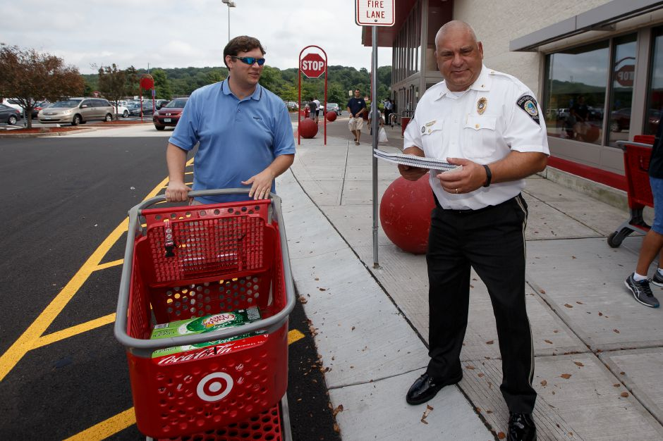 Matt Willis of Kent stops to give a donation to Deputy Chief Palmieri Saturday during Southington