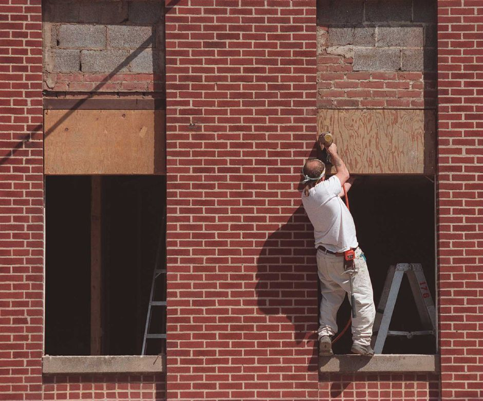 RJ file photo - Steve McConnell of Meriden, a carpenter, uses an air nailer to do some remodeling to the former Eagles Club on Crown Street. The new place will be the Meriden Independent Club and will feature a bar and dance/reception hall. McConnell is a member, May 1999.