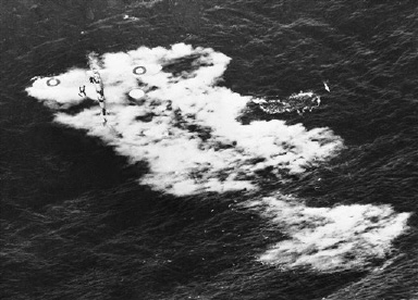 Crew of a barracuda from the British light fleet carrier Vengeance standing on their crashed plane after they had forced landed in the sea, August 29, 1945. All were saved. Note the lifeboat floating, top left, and the positions indicator (A bright yellow circle of canvas above the starboard wing. (AP Photo)