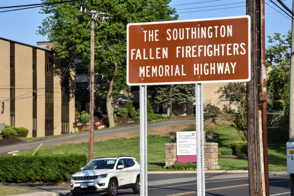 A sign commemorating a portion of Route 120, from Route 332 to Route 10, dedicated to those fallen firefighters of the Southington Fire Department, pictured on Wednesday, May 23, 2018. On Wednesday state lawmakers gathered with firefighters and their families for a dedication ceremony. | Bailey Wright, Record-Journal