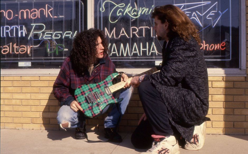 RJ file photo - Guitar whiz Blues Saraceno, left, talks with Teen Beat writer Justin Piccirillo outside a New Haven music store, March 1994.
