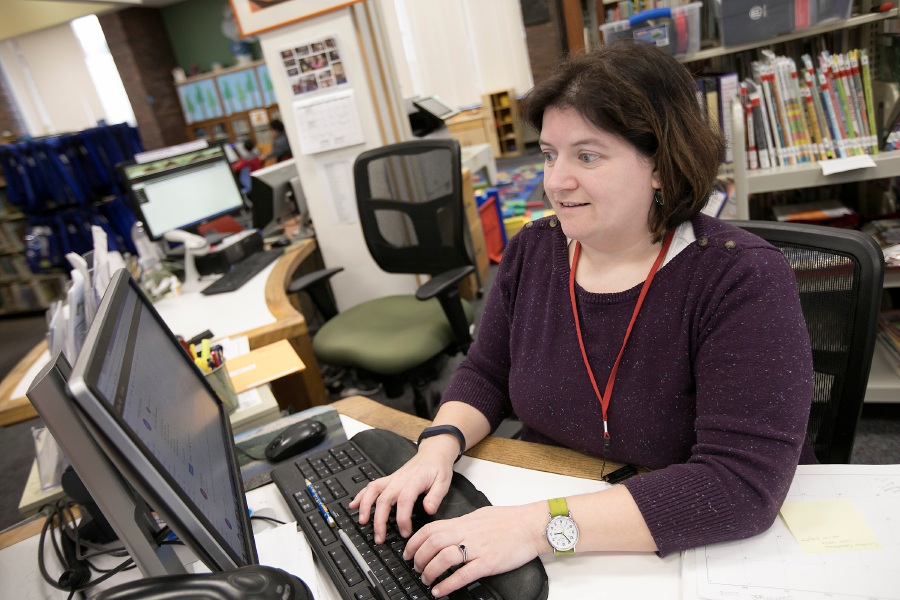 Gretchen DelCegno, head of children services, works at her station at the Meriden Public Library on  Monday, Jan. 29, 2018. Dave Zajac, Record-Journal