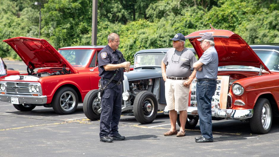 Wallingford Firefighter David Gade speaks with Wayne and Ned Rydzy, of Wallingford, at the Wallingford Fire Department