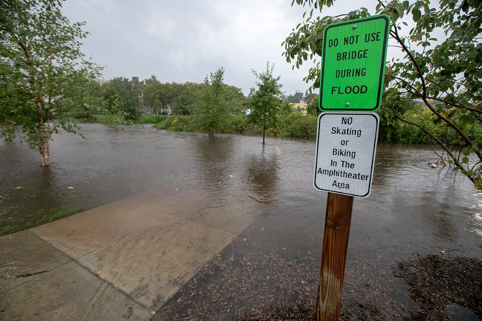 Flood waters overtake a walk bridge on the Meriden Green, Tuesday, Sept. 25, 2018. Heavy rain Tuesday evening closed roads and flooded basements of local homes. Dave Zajac, Record-Journal