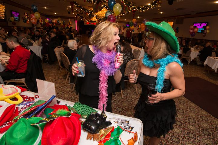 Michele Fredericks of Cheshire left and Christina Regan of Wallingford pick out props for the photo booth Thursday during New Years eve celebration at Zandri
