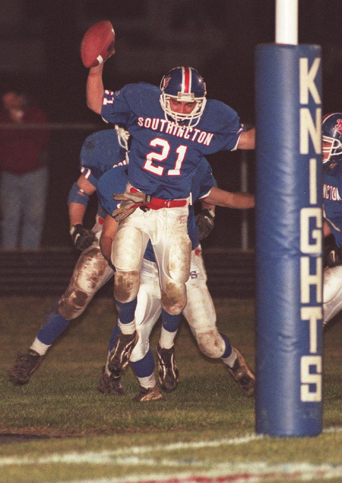 RJ file photo - Mike Cyr celebrates his interception return for a Southington touchdown in the first minute of the second quarter Dec. 1, 1998.