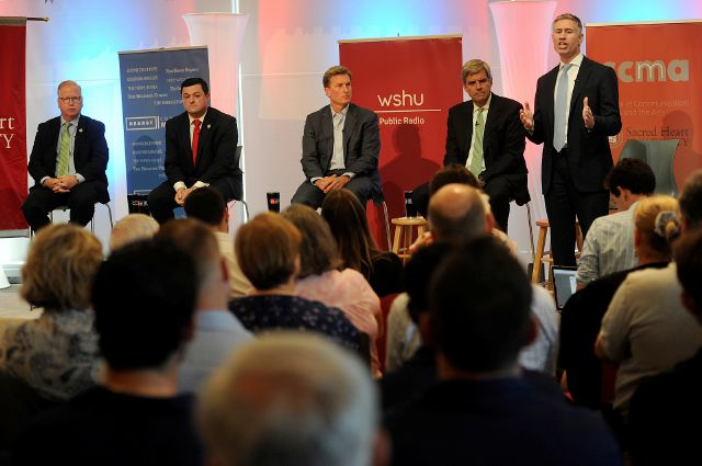 FILE - In this Tuesday, July 24, 2018, file photo, from left, Republican candidates for governor Mark Boughton, Tim Herbst, Steve Obsitnik, Bob Stefanowski, and David Stemerman face off in a Hearst Connecticut Media sponsored debate at Sacred Heart University in Fairfield, Conn. Democrats and Republicans go to the polls in the most crowded primary field in Connecticut