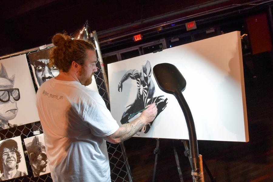Tyler Morris, of Wethersfield, works on a Spiderman painting at RAW Connecticut. Around 40 artists, most from Connecticut, gathered at the Oakdale Theater in Wallingford Wednesday, August 21, 2019, for an annual RAW Artists event. The artists, which varied from painters to makeup artists and photographers, showcased their art in booths, and performers took the main stage. | Bailey Wright, Record-Journal