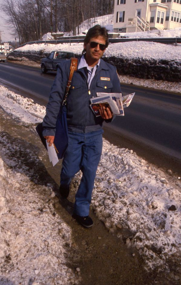 RJ file photo - Southington letter carrier Tom Wallenta delivers mail to a home on his North Main Street route Jan. 21, 1994.