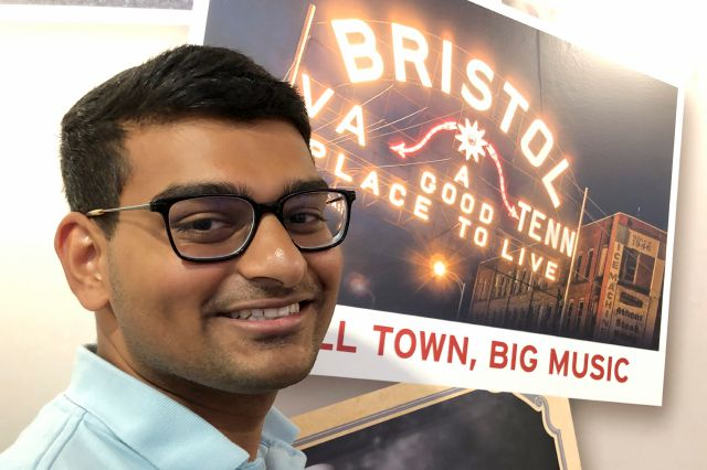 In this June 26, 2019 photo, Ashish Bibireddy, 23, poses for a photo at the Birthplace of Country Music Museum in Bristol, Va. Ten medical students were on a tour of the city organized by a medical school with the aim of luring them to practice in rural communities facing health care shortages after graduation. (AP Photo/Sudhin Thanawala)
