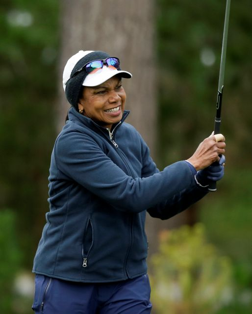 Condoleezza Rice follows her drive from the first tee of the Spyglass Hill Golf Course during the second round of the AT&T Pebble Beach National Pro-Am golf tournament Friday, Feb. 8, 2019, in Pebble Beach, Calif. (AP Photo/Eric Risberg)