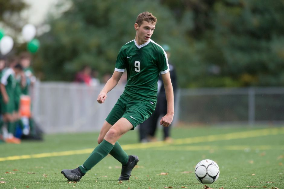 Maloney's Ben Pierce looks to cross against Platt Monday at Falcon Field in Meriden. Pierce scored four goals and Maloney won 5-1.