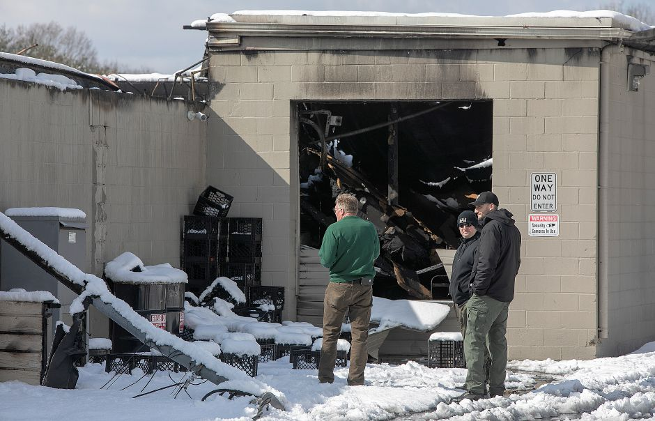 Investigators look over the rear section of Tops Marketplace, 887 Meriden-Waterbury Turnpike in Southington, Mon., Mar. 4, 2019. The business was destroyed by fire Sunday night. Dave Zajac, Record-Journal