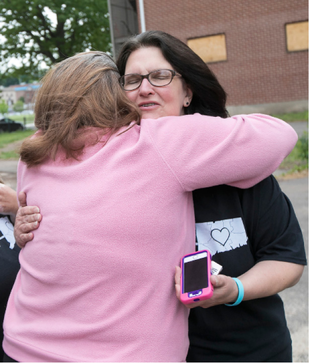 Susan Willette, of Meriden, right, founder of The Roadway for Hope, is hugged by Leslie Carlson of Meriden, during a gathering at the Mills Memorial Apartments in Meriden, Wednesday, May 24, 2017.  | Dave Zajac, Record-Journal